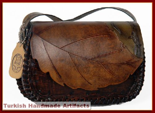 this took me back to when my dad use to do leather working. i can literally smell the purse in my head.  wow!