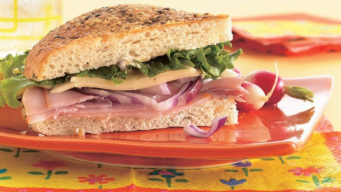 Focaccia bread is a flavorful foundation for this hearty ham, cheese and lettuce sandwich that can be eaten now or wrapped for later.