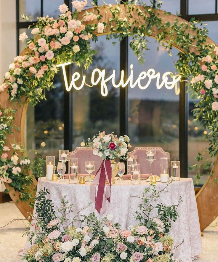 Sweetheart Table with Arch Backdrop and Neon Sign at Bella
