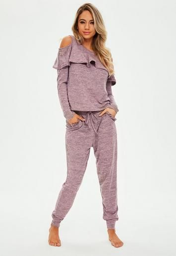 Cold shoulder loungewear set featuring in a pink hue, with double layer front and long sleeve top, and skinny fit cuffed hem trousers.