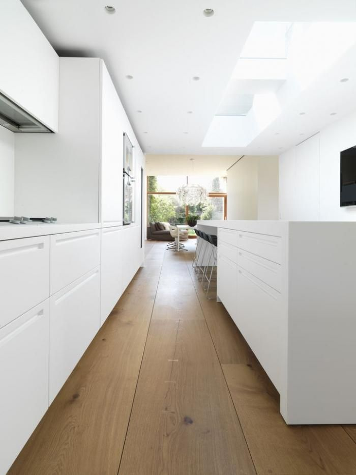 New HeartOak Floors from Dinesen : Remodelista - wide plank oak wood floors, white modern minimalist kitchen