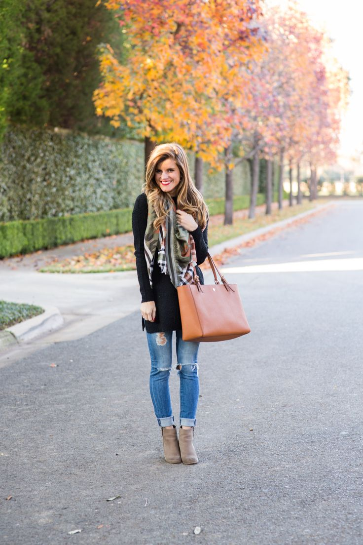 how to wear ankle boots article, cute fall outfit featuring long black tunic, rolled up distressed jeans, grey leather booties, tory burch york tote, southwestern print scarf