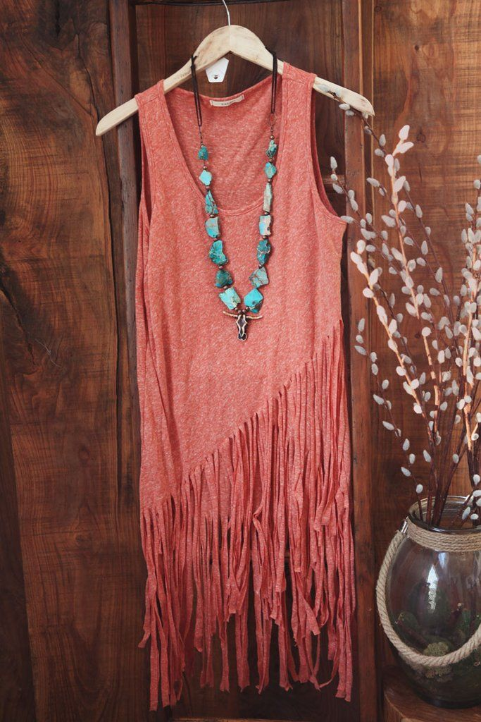 Long Tunic Top with fringe detail that is approximately knee length. MARKDOWN: non-returnable COLOR: CORAL