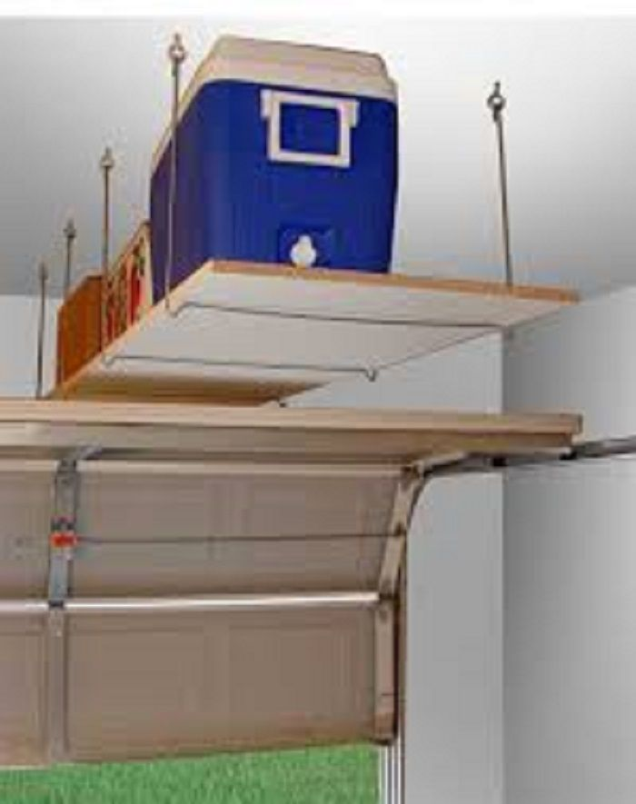 Creative Simple Floating DIY Shelving Unit Above Garage Door To Hold  Functional Boxes With Lots Of