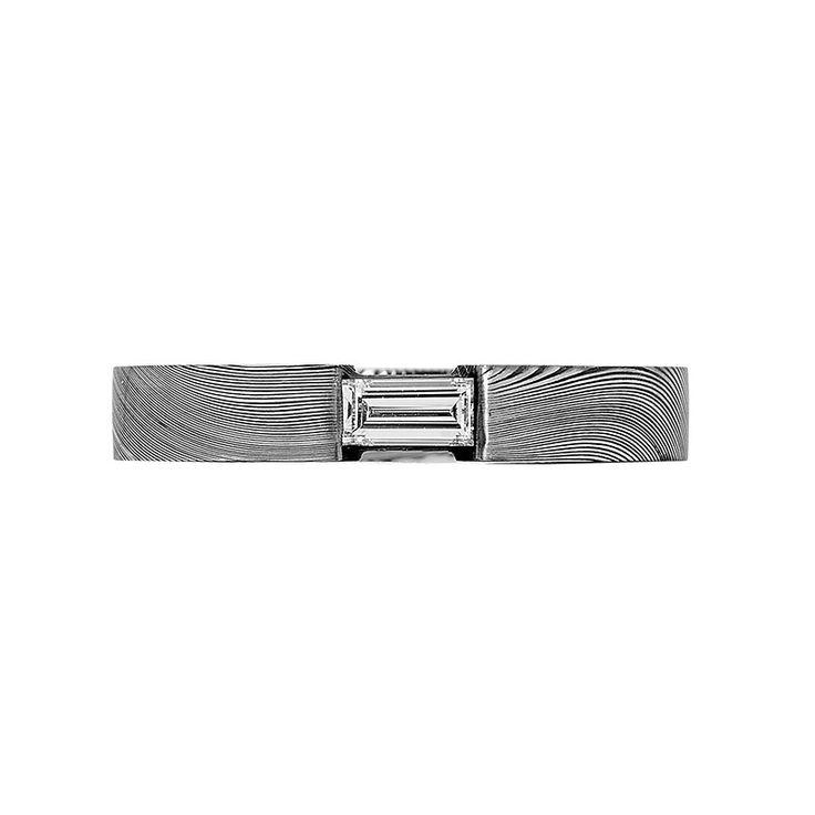 Damascus Steel Collection // Rohan Jewellery // A fingerprint Damascus steel ring with a baguette cut diamond.