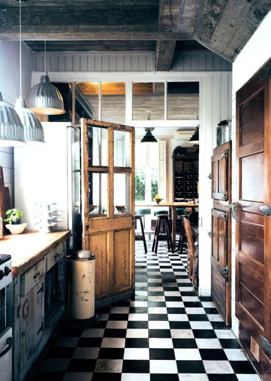 black and white checkered floor with old wooden doors and pendant lighting