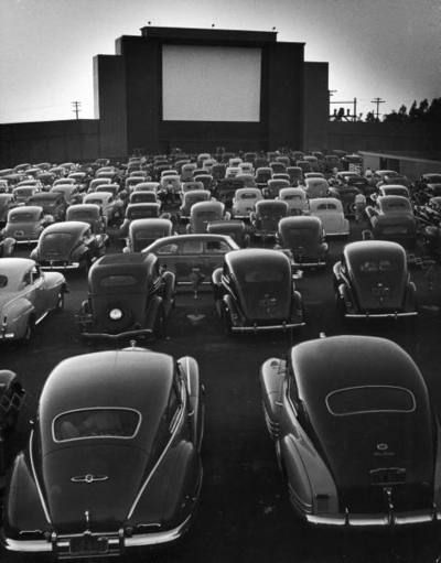Cars Filling Lot at New Rancho Drive in Theater at Dusk Before the Start of the…