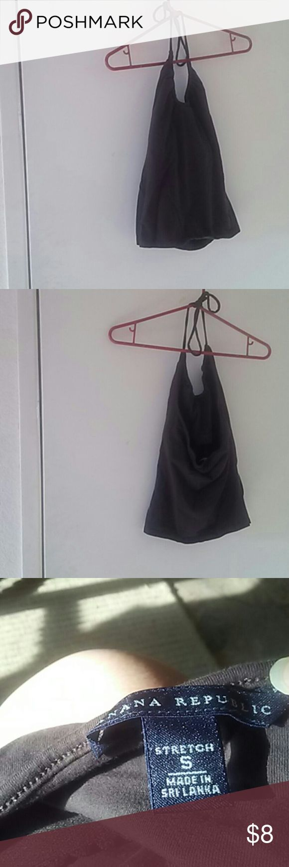 Banana Republic brown halter top Brown halter top from Banana Republic.  In EUC.  Shows no signs of wear.  Cotton blend material.  Halter strap is adjustable and has a built in bra.  Draw string design.  Discount on bundles.  No trade or paypal. Banana Republic Tops Tank Tops