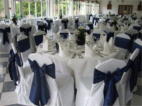 white chair covers with midnight blue taffeta sashes decor