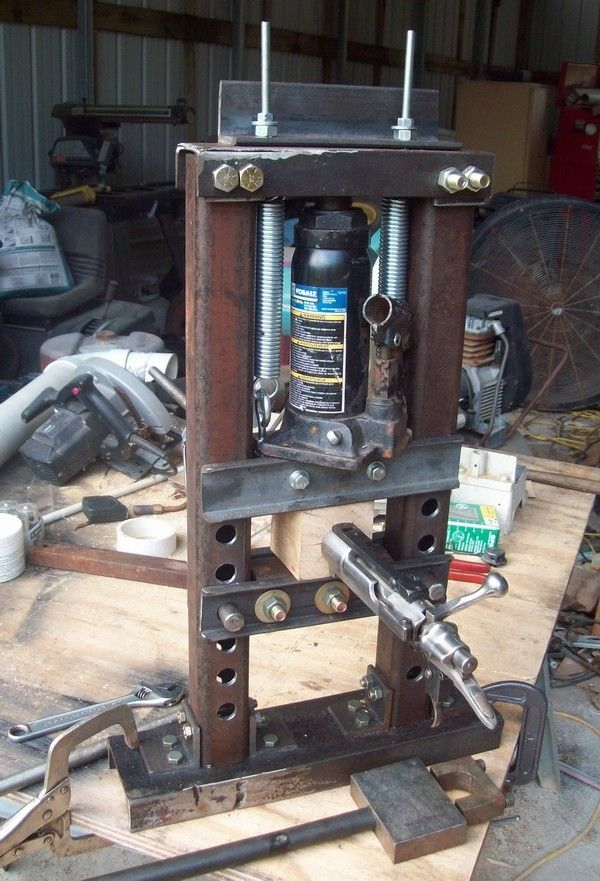 Mini Hydraulic Press by Hotrod Lincoln -- Homemade mini hydraulic press fabricated from 2x2 steel and powered by a 12-ton bottle jack. http://www.homemadetools.net/homemade-mini-hydraulic-press-2