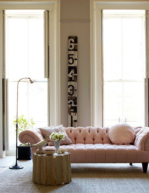 typically masculine chesterfield sofa- made feminine with a light pink leather