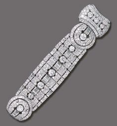 AN IMPRESSIVE ART DECO DIAMOND BRACELET  Of articulated openwork design, composed of a series of pavé-set diamond links, each centering upon an old European-cut diamond or baguette-cut diamond arched link, enhanced by similarly-set trim, joined by two pavé-set diamond circular panels, to the large cartouche-shaped clasp of similar design, mounted in platinum and 18k white gold, circa 1935, 7 ins., with French assay marks and maker's mark  Price Realized   $65,725  Estimate $40,000 - $60,000