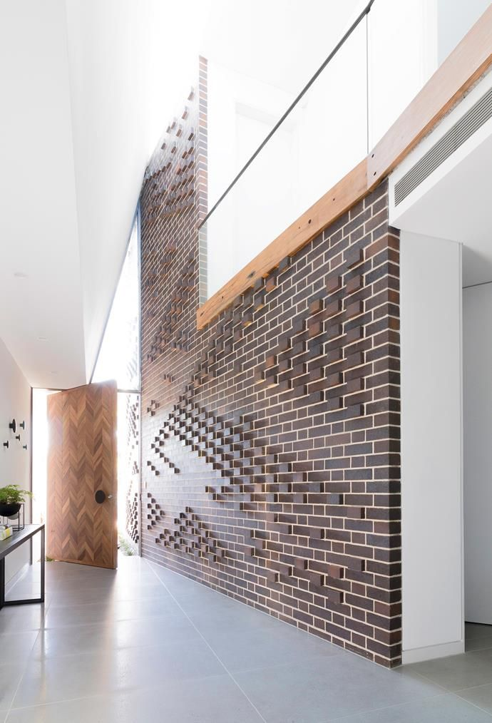"""Protruding bricks create an eye-catching pattern on this feature wall. [PGH Bricks](http://www.pghbricks.com.au/?utm_campaign=supplier/