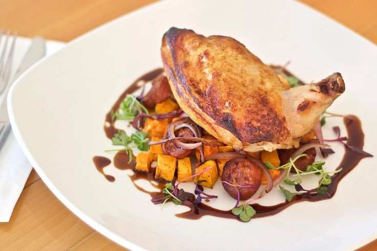 OVEN ROASTED CHICKEN Served on a bed of roast sweet yams, pumpkin and chorizo finished with au jus 1609 Restaurant & Lounge | Food Photos