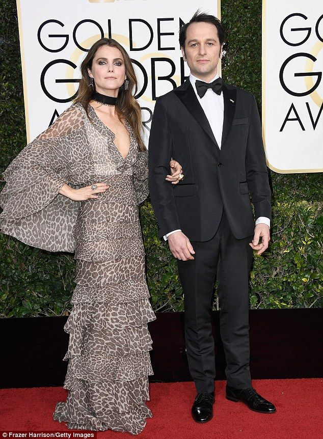 At least they have each other: The Americans' Keri Russell and Matthew Rhys were both nominated but lost Golden Globes during Sunday's live NBC telecast from Beverly Hills