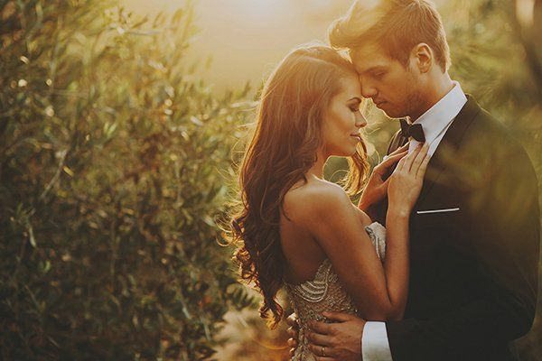 Capture your loving moments in the golden hour for an amber romance effect.Related: The Most Popular Wedding Photos