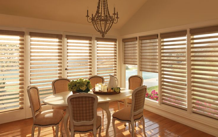 Stunning solution to enhance the light in this dining room with Luxaflex® Pirouette® Shadings