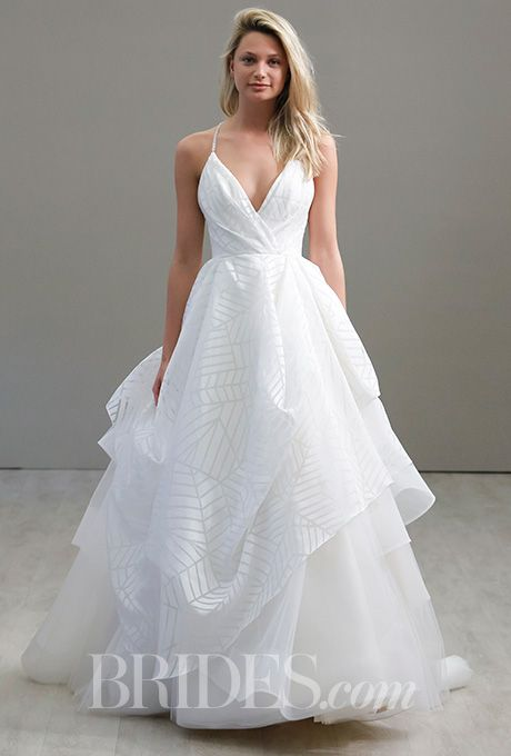 Check out the subtle pattern on the layered skirt of this @hayleypaigejlm wedding dress | Brides.com