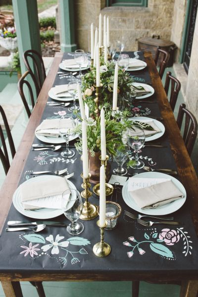 Painted black paper as a tablecloth: http://www.stylemepretty.com/wisconsin-weddings/madison-wi/2014/12/01/folk-inspired-styled-shoot-in-madison-wi-at-the-livingston-inn/   Photography: April Violet - http://www.aprilviolet.com/