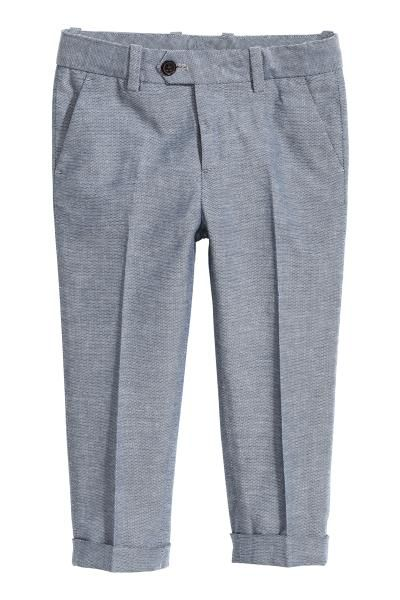 Suit trousers: Suit trousers in cotton chambray with an adjustable elasticated waist, zip fly with a button, side pockets and welt back pockets with a flap and button. Creases and turn-ups at the hems.