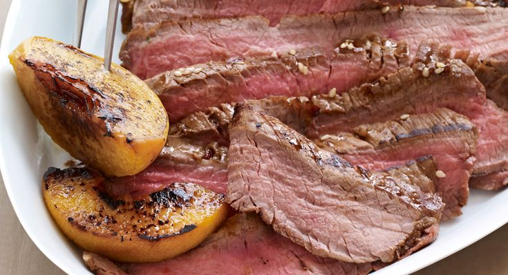 Spicy Teriyaki-Marinated Flank Steak with Grilled Peaches: Massaging this sweet and spicy teriyaki marinade into flank steak for just five minutes is all you need to get maximum flavor....