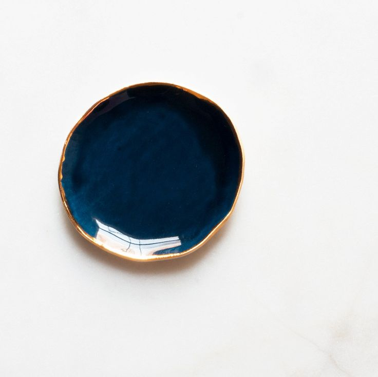In love with all of her products, and especially love the deep richness of the cobalt with the gold.  Ring Dish in Navy with Gold Rim – Suite One Studio