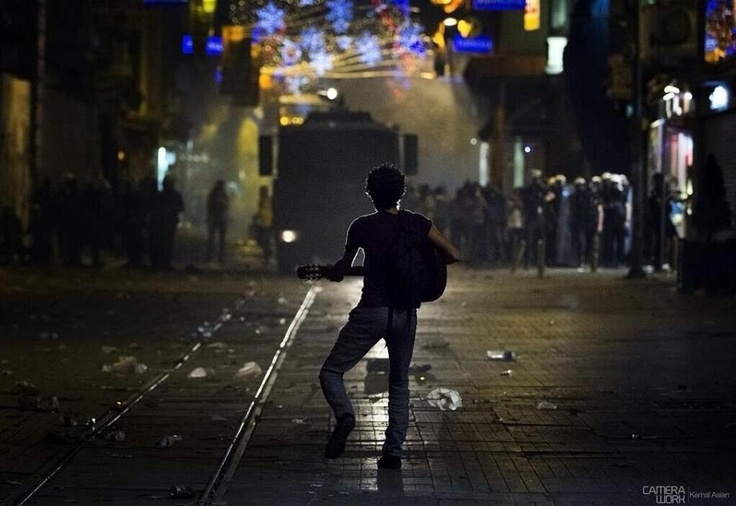 An amazing image of a man in the path of a police vehicle via Occupygezi