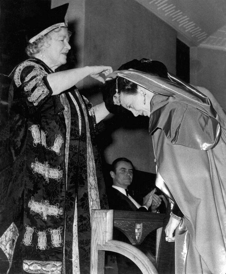 carolathhabsburg:   Queen Margrethe II of Denmark recieving an honoris causa from Queen mother Elizabeth of Great Britain, in London university. Prince Henrik looks on.