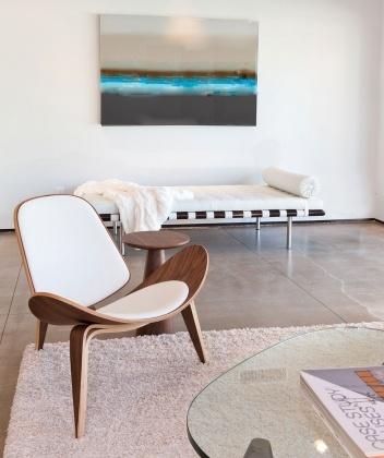 H. Wenge style Shell Chair  available at http://www.houseandhomespalmsprings.com/online-shop.html