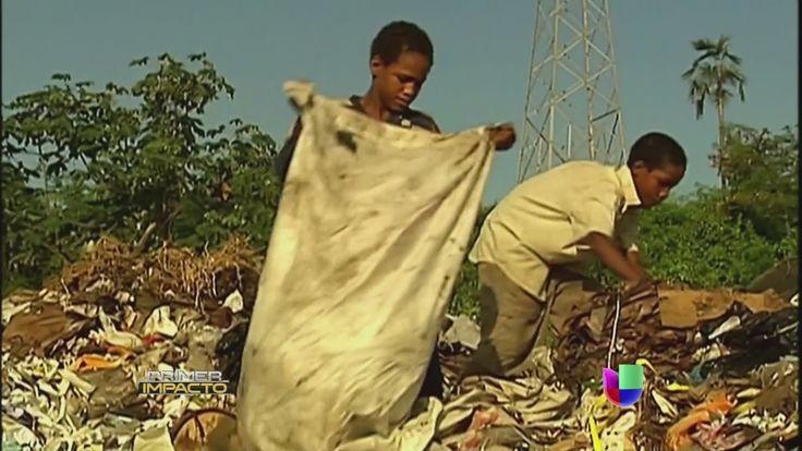 """'Archivos de Impacto': Niños pobres trabajan """"nadando"""" entre la basura -..."""
