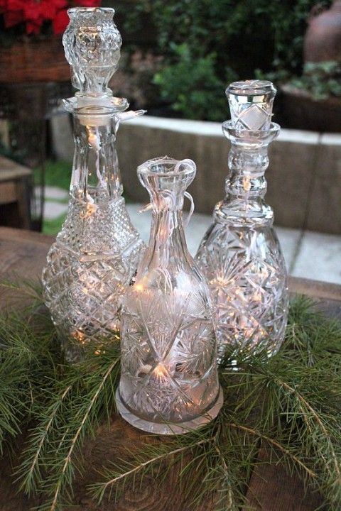 Battery lights in old vintage decanter collection from our families. This would be a festive way to display them at Christmas.