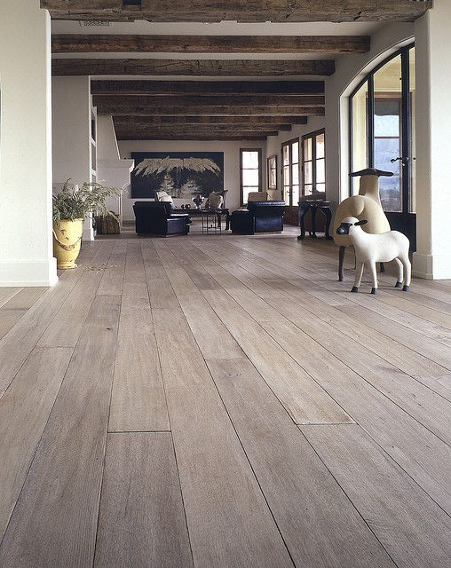 I'm hoping my white oak wood floors can be made to look something like this...more cool and driftwood-like than warm, honey tones...