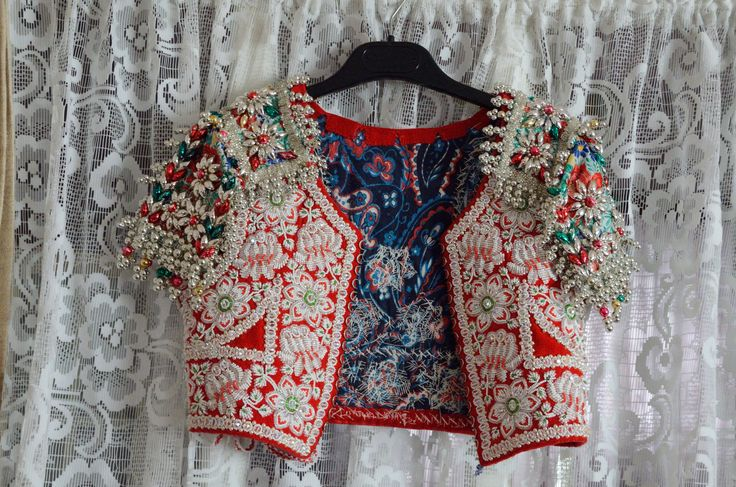 Girl's waistcoat, decorated with beads and sequins.