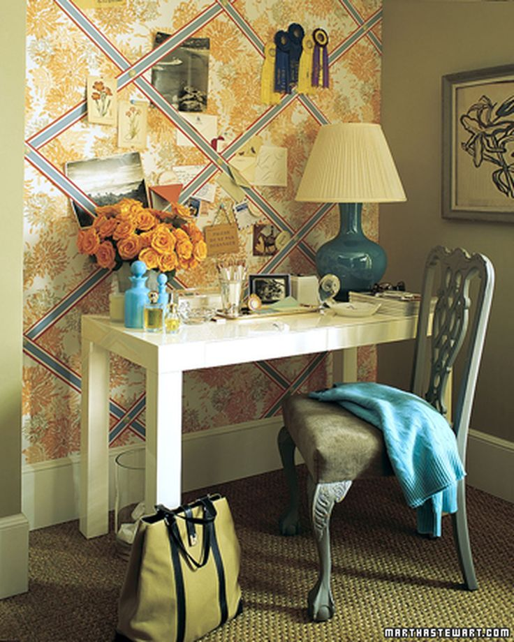 Make this bulletin board floral with fabric and crisscrossed with ribbons