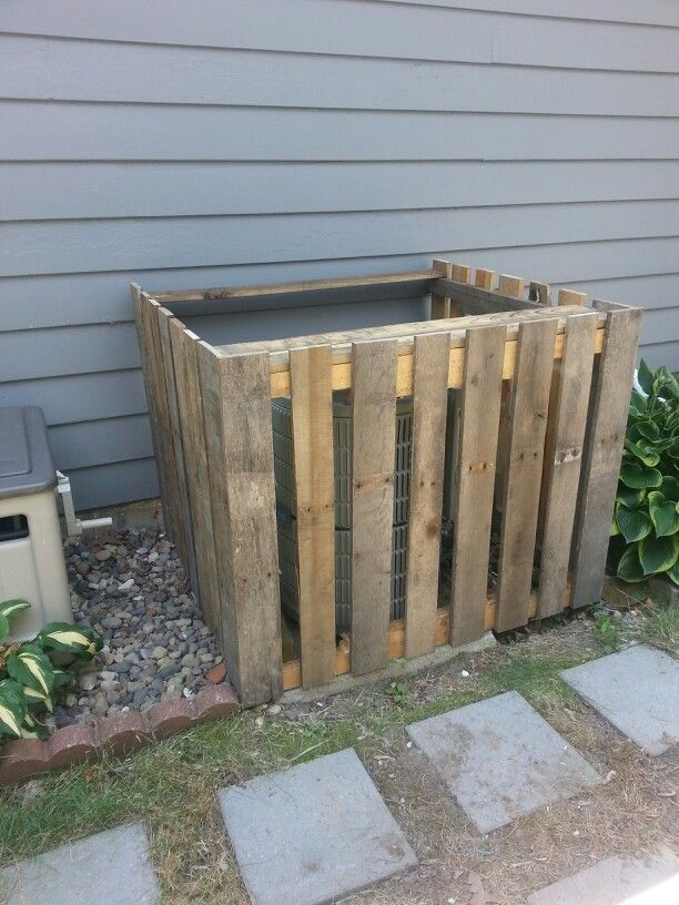 Pallet board air conditioner fence use instead to hide - Air conditioner cover ideas ...