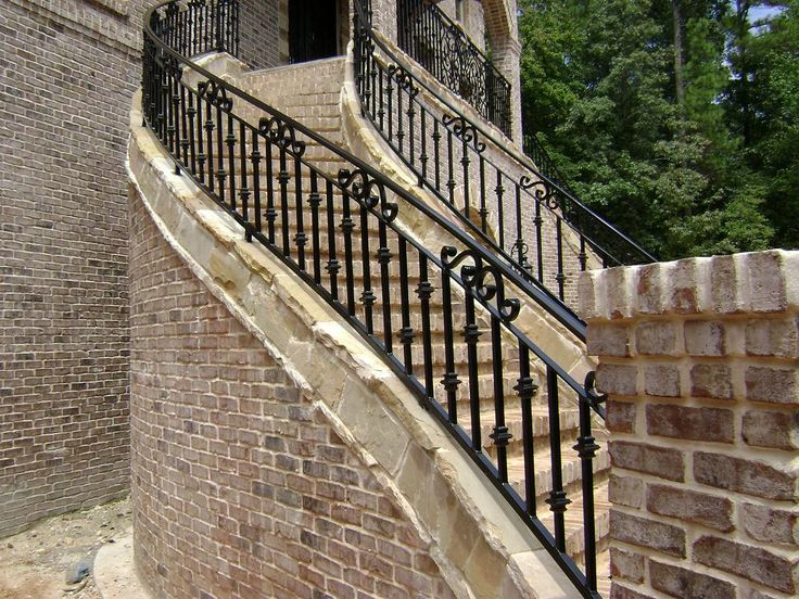 Exterior Spiral Outdoor Stair Railing Ideas Using Black Iron Material Also Exposed Brick Steps Simple On Front Porch And Backyard Deck