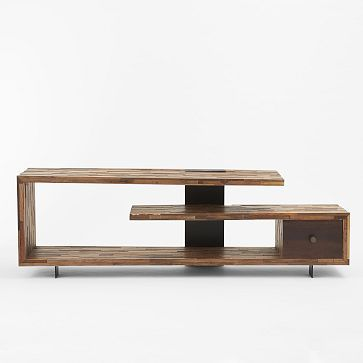 A mix of walnut and reclaimed peroba woods makes up the Staggered Wood Console. With its rough-hewn, elevated silhouette perched on solid wo...