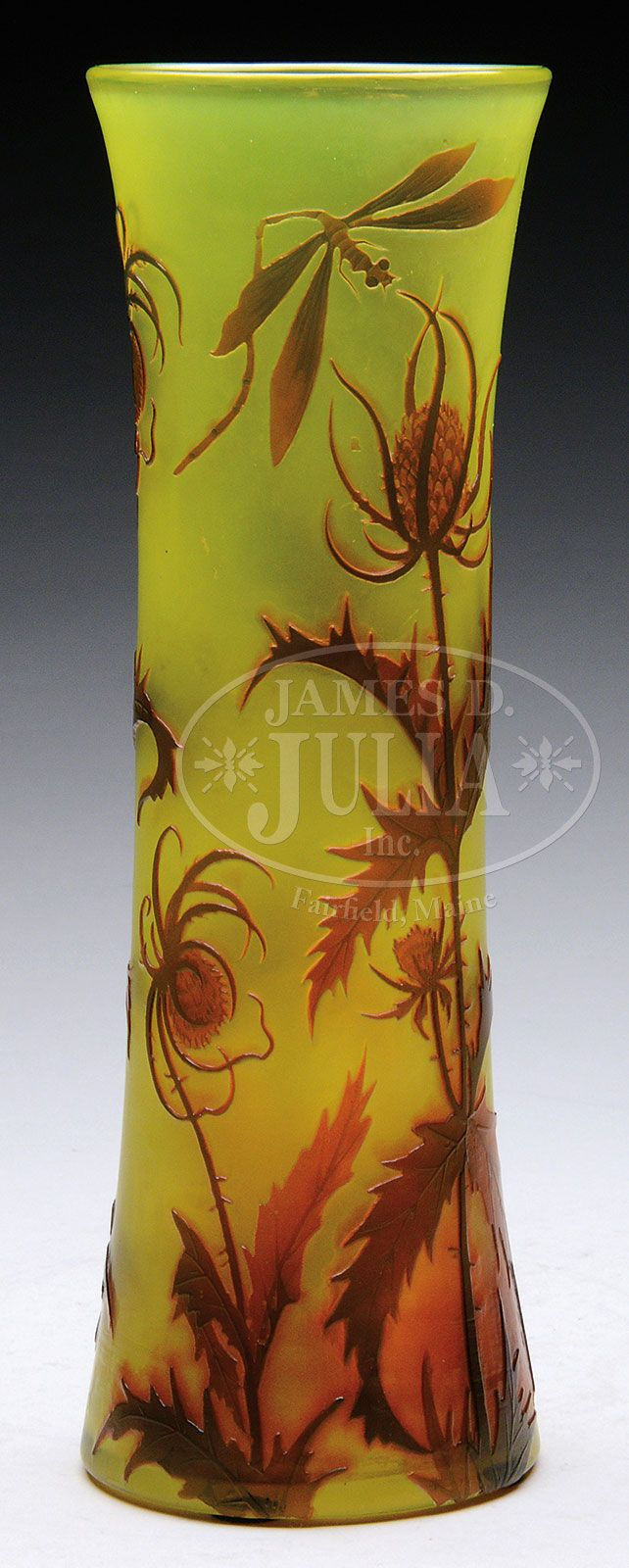 """DAUM THISTLE AND DRAGONFLY CAMEO VASE. Daum Nancy vase is decorated with red layer of cameo thistle plants and a dragonfly in flight set against a bright citron yellow translucent background. Signed on the underside with etched """"Daum Nancy"""" and Cross of Lorraine."""