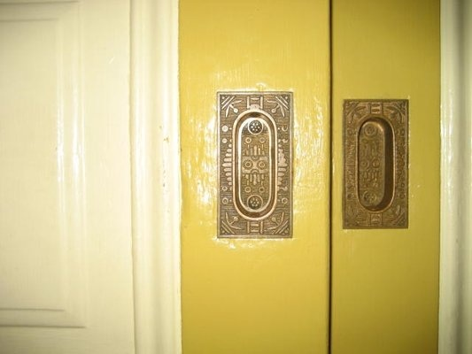 Beautiful pocket door hardware in the Winchester Mystery House