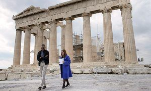 Obama with Eleni Banou, Ministry of Culture director of Ephorate of Antiquities for Athens, during a tour of the Acropolis.