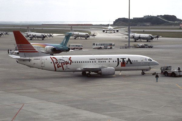 Japan TransOcean Air-JTA (JP) Historic fleet  Boeing 737-4K5 JA8954 aircraft, with the sticker ''Papas & a Swordfish'' on the airframe, parked at Japan Okinawa Naha airport.