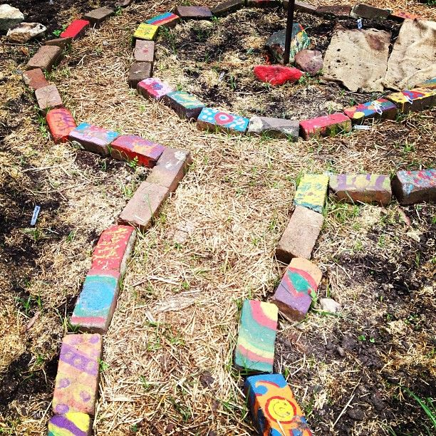 Let kids paint the bricks used to border your garden beds. Such a cute, fun idea for children.