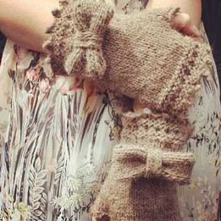 Lace and bows fingerless mittens by In2twine