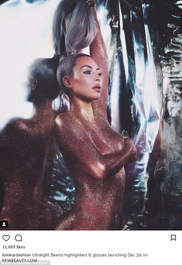 She's a shining star! Kim Kardashian had glitter all over her nude body in the new promotional picture for her upcoming Ultralight Beams highlighters and glosses for KKW Beauty