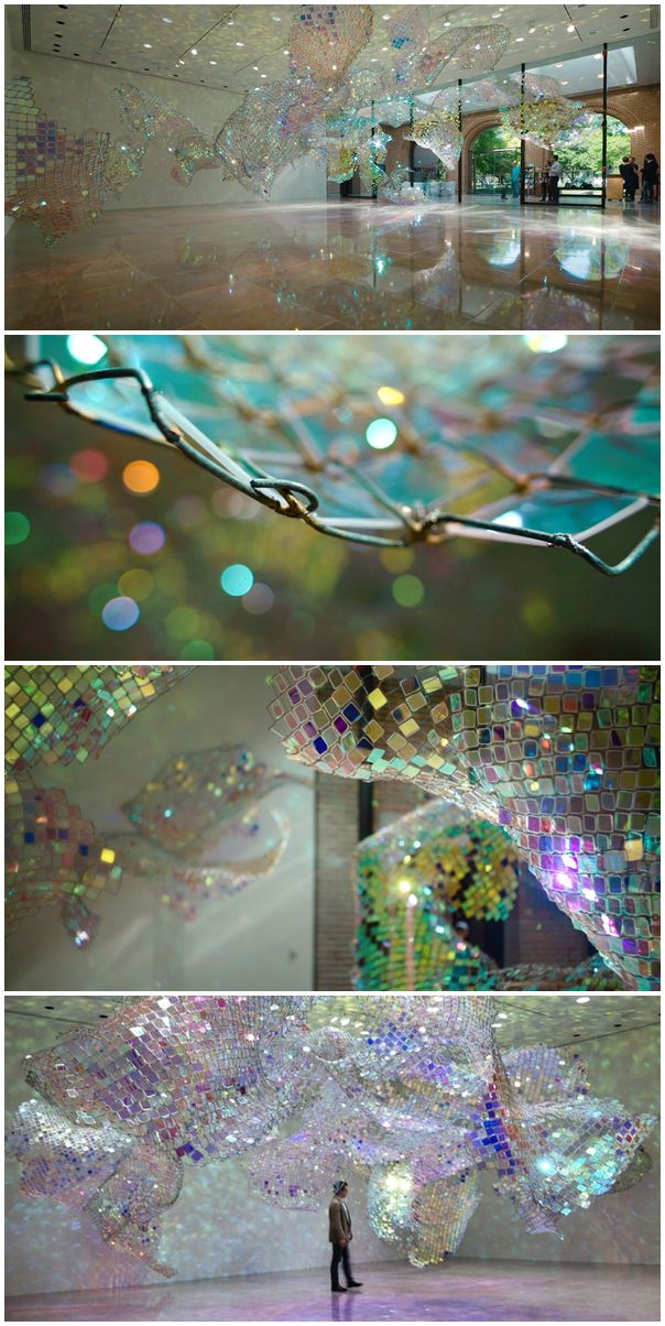 Soo Sunny Park's Unwoven Light - Composed of 37 individual sculptural units, the installation uses iridescent plexi-glass embedded in pieces of a chain link fence to cast shimmering, colorful reflections across the spacious gallery.