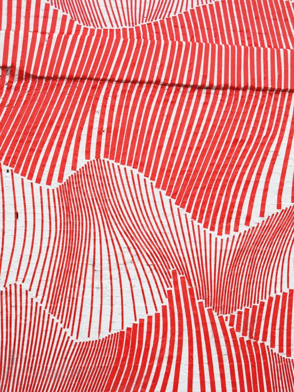 No info on this. Looks like it was realized on a white brick wall. It's brilliant, whoever made it. Instant textile design.