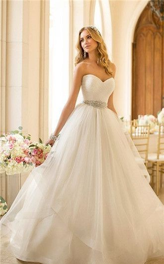 This ballgown wedding dresses is straight out of a fairytale! We love the crystal belt detail that sets it apart from the rest.