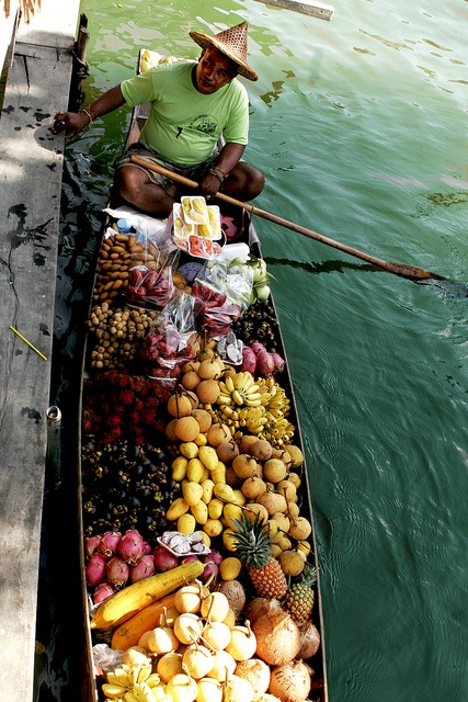 Floating Market, Thailand - by Diego Rios    The floating market is among the most-photographed destinations in Thailand.    The river and 'klong' markets give a realistic glance of how daily life must have been in earlier times.    The floating market is where the sellers' boats laden with a wide variety of tropical fruits, flowers, vegetables and fresh produce, come to meet and barter their products with other traders.