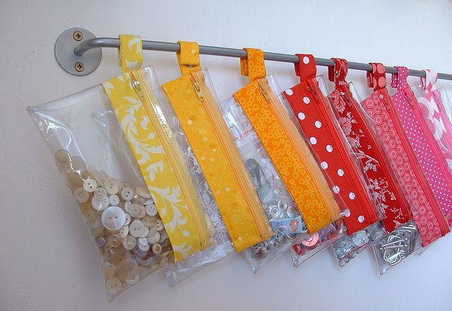 clear vinyl zipper pouches, with a snap ring to hang on an ikea kitchen rod. brilliant storage!
