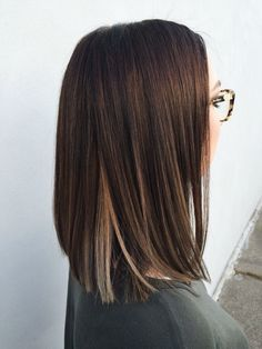 a peek of color- Straight hair. Shoulder lenght hairstyle.